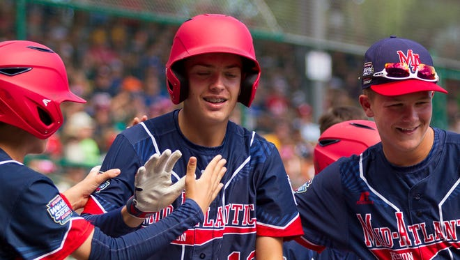 Ryan Harlost, second from left, celebrates with the Maine-Endwell team after his two-run home run, in the first inning Monday, at the Little League World Series.