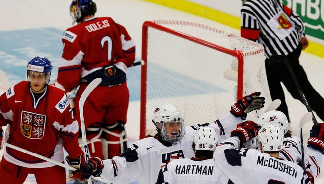 Team USA players celebrate their first-period goal against the Czech Republic.