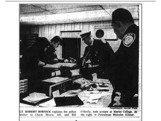Lt. Robert Hornick explains the police blotter to Chuck Meara, left, and Bill O'Reilly, both seniors at Marist College. At the right is Patrolman Malcolm Kilmer