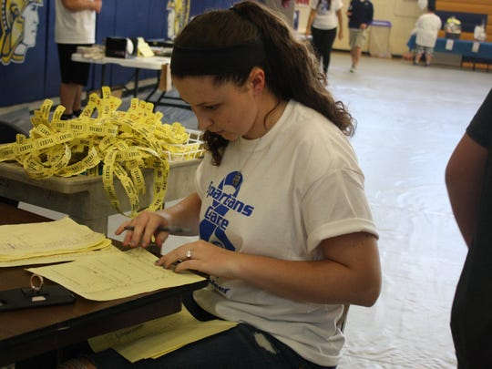 Gabrielle Sawyer, 17, of Maine, was in charge of organizing the basket raffle and silent auction portion of the spaghetti dinner fundraiser.