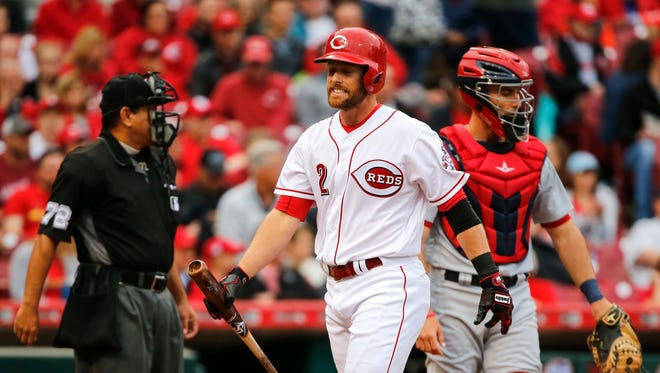 Cincinnati Reds shortstop Zack Cozart (2) reacts after striking out in the second inning against the St. Louis Cardinals June 7, 2017, at Great American Ball Park.