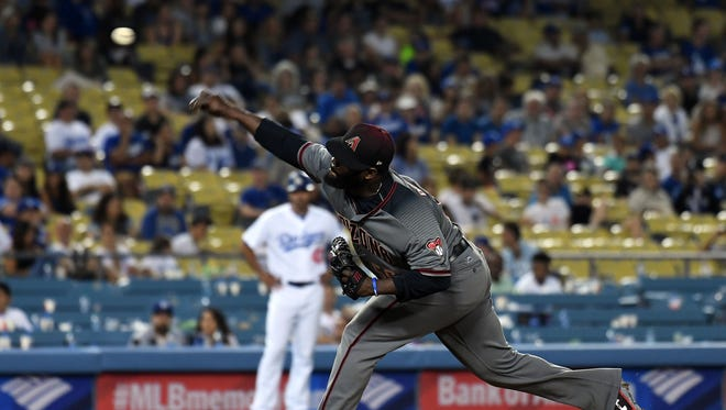 July 6, 2017; Los Angeles, CA, USA;  Arizona Diamondbacks relief pitcher Fernando Rodney (56) throws in the ninth inning against the Los Angeles Dodgers at Dodger Stadium. Mandatory Credit: Richard Mackson-USA TODAY Sports