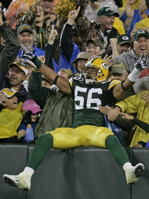 Nick Barnett celebrates after returning a fumble 62 yards for a touchdown during a preseason game at Lambeau Field in 2007.