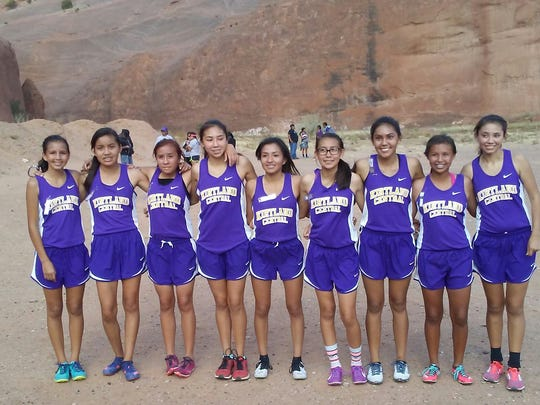 The Kirtland Central girls cross-country team stands for a photo on Friday after winning the District 1-5A championship meet in Gallup.