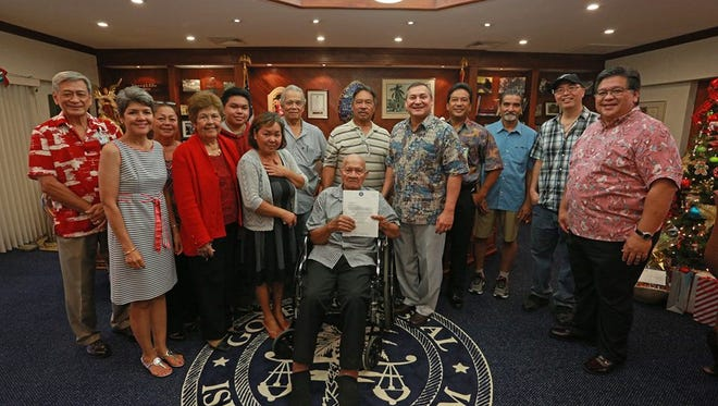 "A ceremony was held Thursday at Adelup for the transfer of land to two families whose properties had been under federal control since World War II. A deed signing ceremony was held for the estates of Josefa Torre Villagomez and Atanacio Cruz Blas, according to the governor's office. The Guam Ancestral Lands Commission finalized the transfer of each property, both located in Barrigada.  ""In this time of renewal, the current generation and the future generation of the original land owners here today can now make use of their property for the benefit of their families,"" Gov. Eddie Calvo said in a released statement. ""I am so honored to be here today to preside over the transfer of such a precious resource, especially on Christmas Eve."" Calvo and other officials were at Thursday's ceremony, including Department of Land Management Director Michael Borja, GALC Commission Chairperson Anita Orlino, Vice Chair Ronald Laguana, Commissioner Ronald Eclavea, Commissioner Anthony Ada, Commissioner Antonio Sablan and Commissioner Augusto Wessling."
