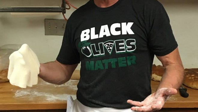 """Paisano's in Albuquerque is making headlines with its """"black olives matter"""" shirts and hats."""