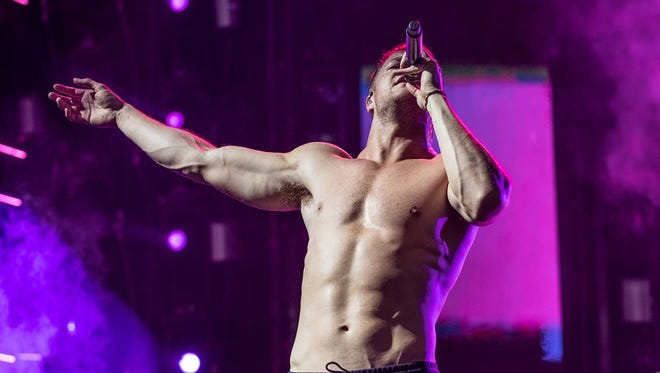 Dan Reynolds performs with Imagine Dragons Friday at Ruoff Home Mortgage Music Center.