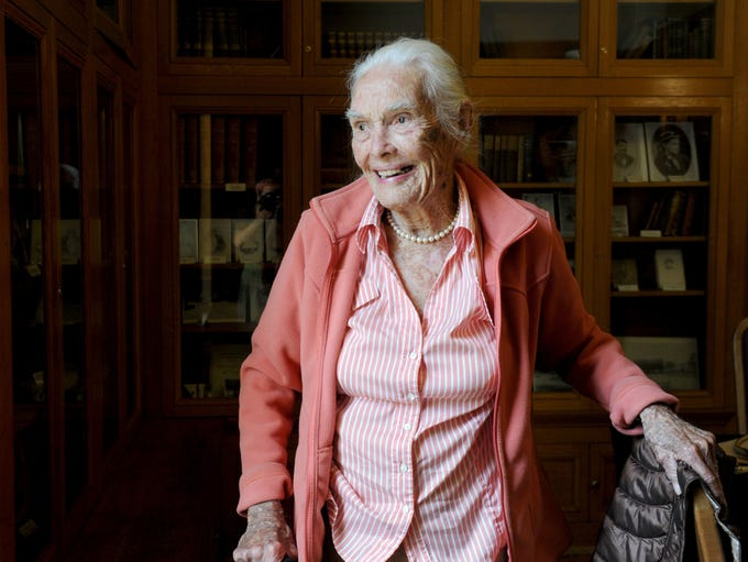 Joanna Bard Newton, 100, walks around the Bard Mansion,