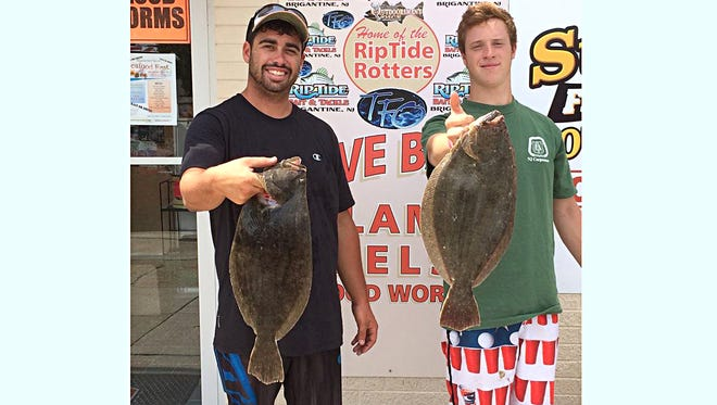 Josh Biondi and Paul Kabala with two nice flounder to 4 pounds.