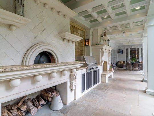 The veranda at 6043 Gilbert Drive includes a Vicenza