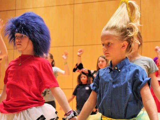 "Performing in ""Seussical"" is a hair-raising experience"