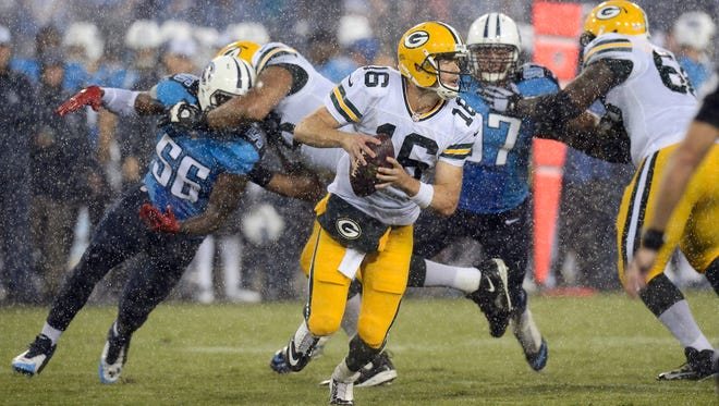 Green Bay Packers quarterback Scott Tolzien (16) scrambles away from Tennessee Titans defenders Akeem Ayers (56) and Karl Klug (97) in the third quarter of a preseason NFL football game Saturday, Aug. 9, 2014, in Nashville, Tenn.