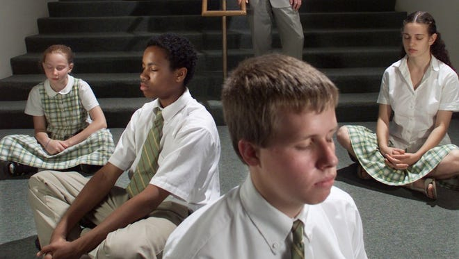 Maharishi School students demonstrate Transcendental Meditation in this file photo from 2001.