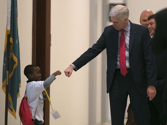 Supreme Court nominee Judge Neil Gorsuch fist-bumps four-year-old Charles Marshall of Dover, Delaware, in between courtesy calls on members of the Senate who will vote on his confirmation.