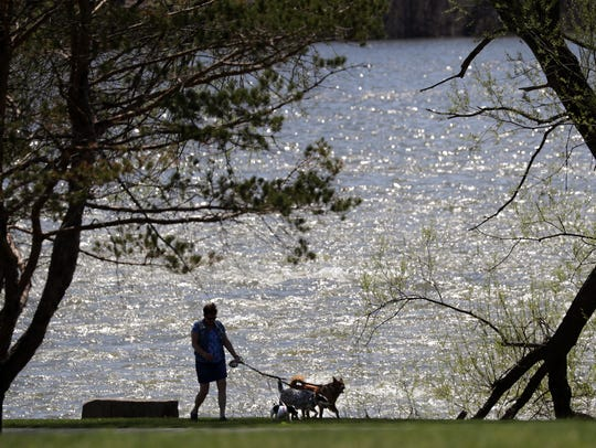 Louiose Becklund, Kaukauna, walks her dogs Monday on