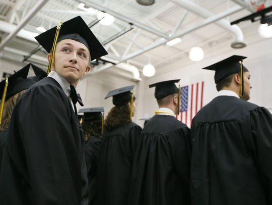 A graduate looks around at the crowd at Buffalo Gap