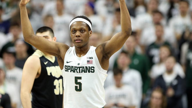 Michigan State guard Cassius Winston gestures to the crowd during a game against Purdue on Jan. 24, 2017.