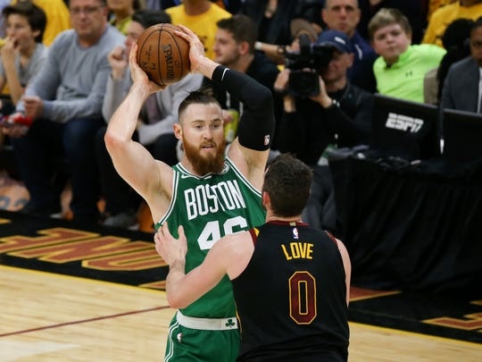 May 19, 2018; Cleveland, OH, USA; Boston Celtics center Aron Baynes (46) looks to pass over Cleveland Cavaliers center Kevin Love (0) during the first quarter in game three of the Eastern conference finals of the 2018 NBA Playoffs at Quicken Loans Arena. Mandatory Credit: Aaron Doster-USA TODAY Sports