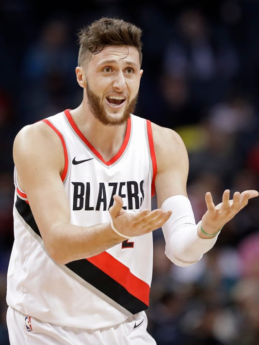 Portland Trail Blazers' Jusuf Nurkic reacts after being called for a foul against the Charlotte Hornets during the first half of an NBA basketball game in Charlotte, N.C., Saturday, Dec. 16, 2017. (AP Photo/Chuck Burton)