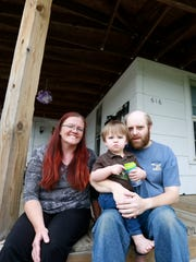 Kim Manteuffel, left, her husband Travis, and 2-year-old