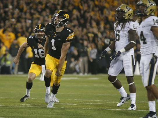 Iowa senior kicker Marshall Koehn watches as he hits