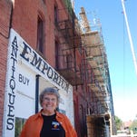 City-County historic preservation officer Ellen Sievert is a strong advocate of renovating historic commercial buildings, including the Arvon Block shown behind her, which houses the Celtic Cowboy Tavern.