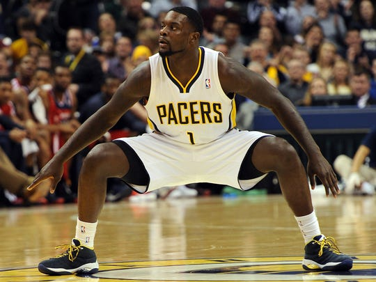 Indiana Pacers guard Lance Stephenson celebrates an assist at mid-court.
