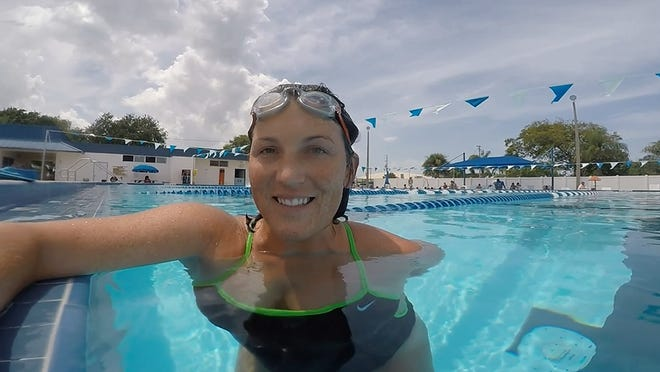 Michelle Mulak stays cool during her workout at the Cocoa Beach Aquatic Center.