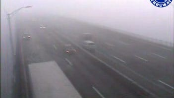Fog envelopes the Tappan Zee Bridge at 7:15 a.m. Friday, Nov. 27, 2015, as seen in a state Thruway Authority traffic camera image. A dense fog advisory was in effect until 9 a.m. The bridge speed limit was reduced to 45 mph.
