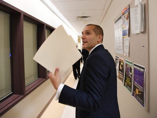 New Jersey Homeland Security Director in a hallway