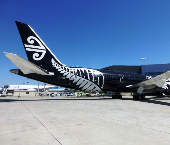 A view of ANZ's new 787-9 airplane in its black livery.