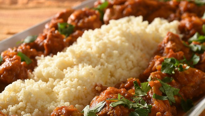 Chicken Curry is shown served with cous cous.