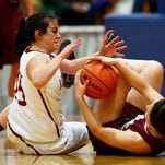 Fort Benton's Miranda Woodhouse, left, and Simms-Augusta's Roxie Parenteau fight for a loose ball Thursday during the Girls' Northern C Divisional basketball tournament at the Four Season Arena. TRIBUNE PHOTO/LARRY BECKNER