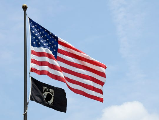 The flags of the United States of America and its POW-MIA