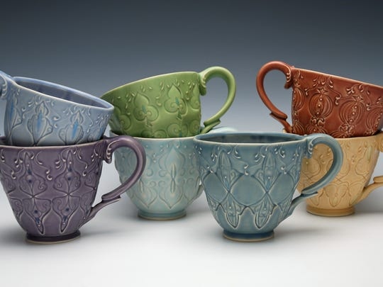 Artist Kristen Kieffer of Baldwinville, Massachusetts, gets creative with cup grouping.