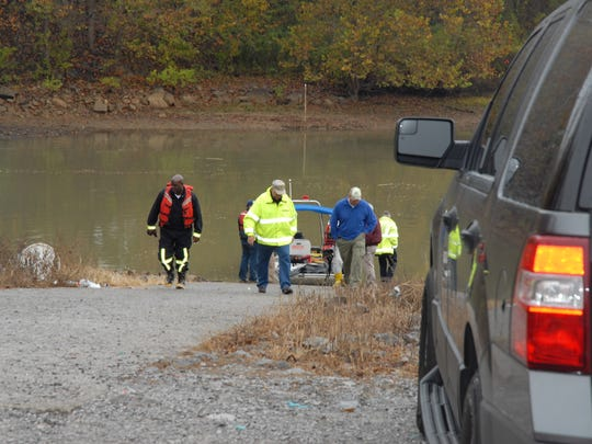 Rescue crews work at the Cumberland River where a man's body was found.