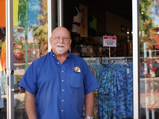 Don Soja, 68, is an assistant manager at Bear Wear on Arenas Road. He stands outside his store with the door open, hoping to invite customers inside.