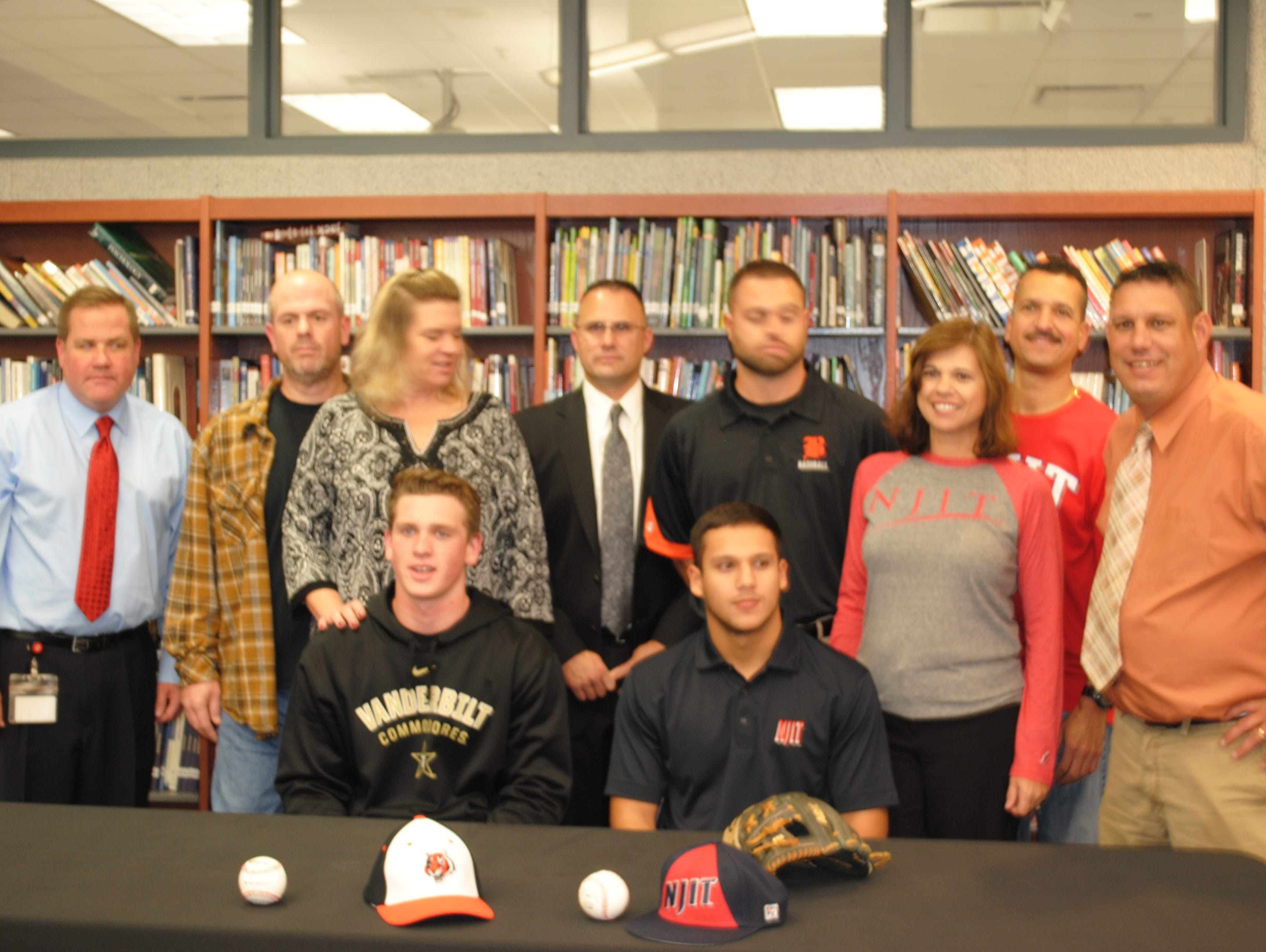 Barnegat baseball players Jared Kacso (NJIT) and Jason Groome (Vanderbilt) sign their NLI surrounded by family and coaches.