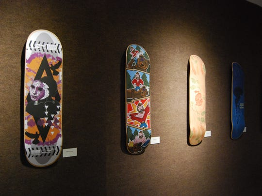 An art show at St. Clair County Community College uses skateboard decks as canvases.