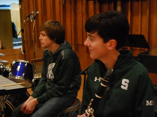 """Anthony Rumzek, 17, left, and Nick Dewey, 17, prepare to rehearse the Christmas musical """"Unspeakable Joy"""" at First Congregational Church in Port Huron."""