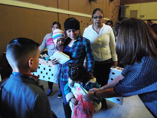 At the Castroville Community Feast on Thanksgiving Day, families received books for the kids and a box of fresh vegetables to mark the holiday.
