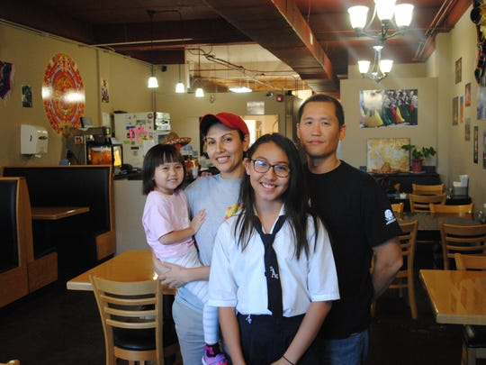 Inside Tacos Sinaloa with Elizabeth and John Liauw and their children Eva Jean, 3 and Nicky, 12.
