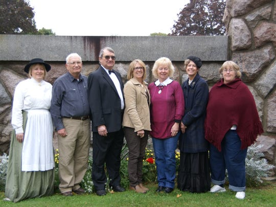 Eaton County Historical Commission members pictured (from left) Deb Malewski,  Chairman Randall Tooker, Rich Rybicki, Paula McCloy, Coral Hanje, Julie Kimmer (Courthouse Square Manager), and former member Joe Ann Nehmer. Not shown: Tom Raymond, Roger Eakin, Pat Tirrell, Joy Black, Jan Sedore. The group is preparing to write a second book about local history.