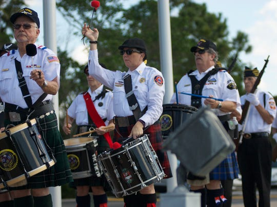 Members of the Guns & Hoses Drum and Pipe Corps provide music for the 19th Iwo Jima Anniversary Ceremony on Sunday at Four Mile Ecological Park in Cape Coral.