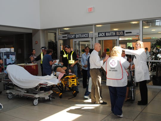 Participants gather in a crisis scenario at Ocean Medical Cener of Brick.