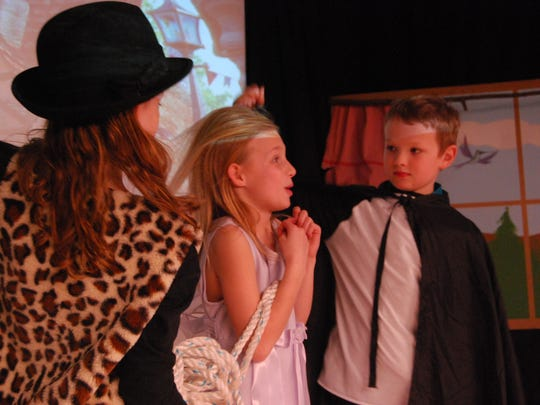 "Bad guys, Hannah Gentner, left, and Jake Gentner reveal kidnapped princess Allison Fournier  during a dress rehearsal for ""Happily Forever After."""