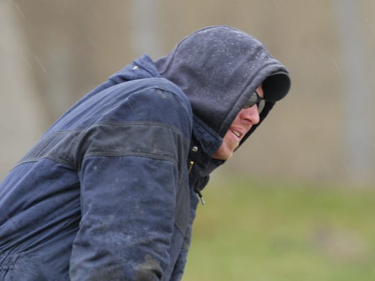 Enbridge employee Brad Barrett endures the cold and the freezing rain during a training exercise on Wednesday.