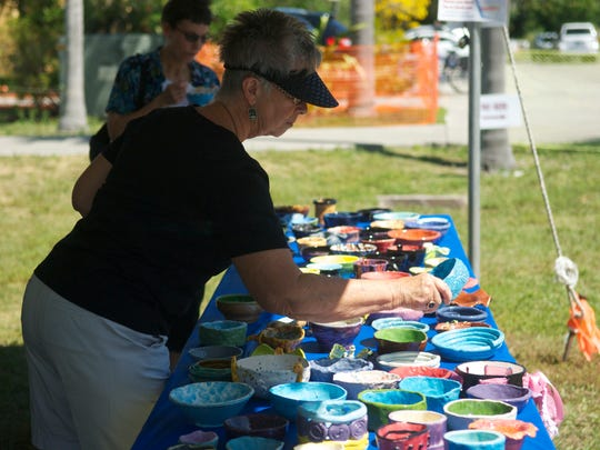 Marley Lombard looks to select her bowl at the second annual Empty Bowls Event  on Sunday at the Alliance for the Arts on McGregor Boulevard.