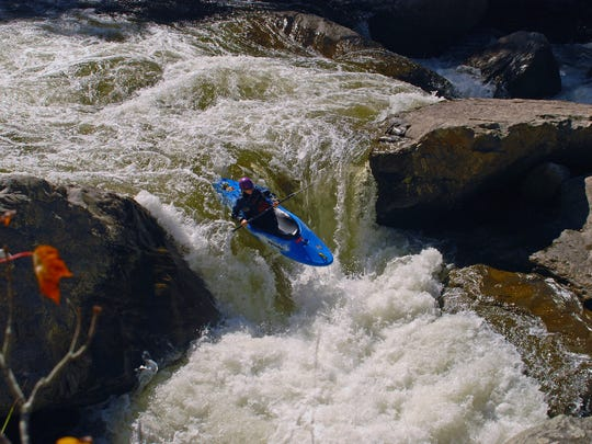 Kayaker in Russell Fork.