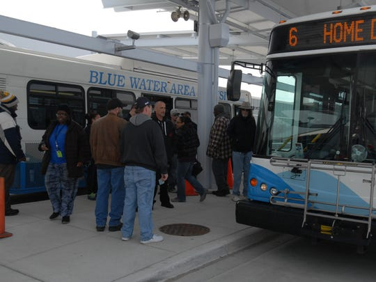 Passengers head toward their buses about noon Wednesday